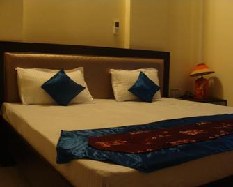 Hotel Abhinandan Grand - Dehradun - Bedroom