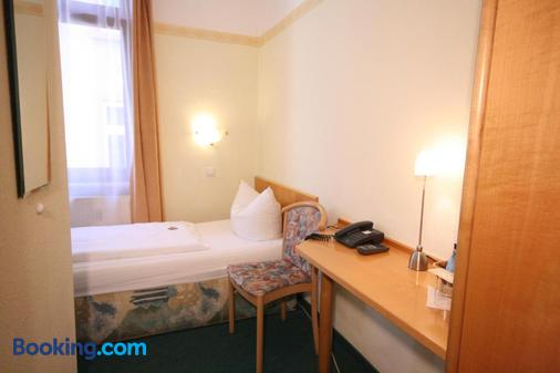 Hotel Classic Inn - Heidelberg - Phòng ngủ