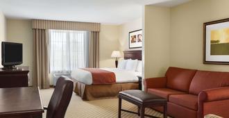 Country Inn & Suites by Radisson Savannah Airport - סאוואנה - חדר שינה