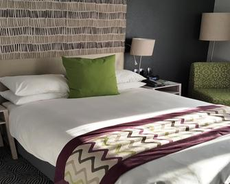 Holiday Inn Johannesburg Airport - Йоханнесбург - Спальня
