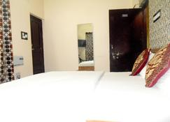 Hotel Awaas Corporate Inn - Патна - Спальня