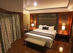 Golden Tulip Jaipur - Jaipur - Bedroom