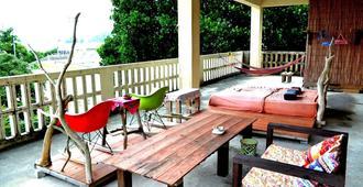 Asian Guesthouse Border - Hostel - Nago - Balkon