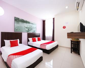 Oyo 712 Hotel Corridor - Gambang - Slaapkamer
