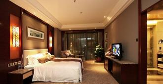 Empark Grand Hotel Changsha - Changsha - Schlafzimmer