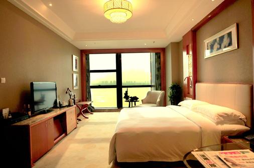 Empark Grand Hotel Changsha - Changsha - Bedroom