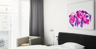 Augarten Art Hotel - Graz - Schlafzimmer
