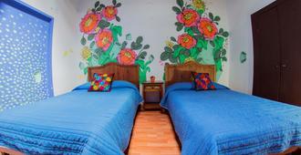 Gente de Más Hostel - פואבלה - חדר שינה
