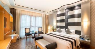 Swiss International Palace Hotel Manama - מאנאמה - חדר שינה