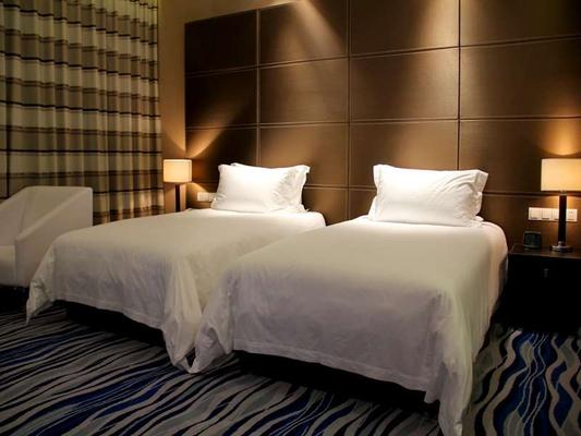 Brigh Radiance Hotel Yantai - Yantai - Bedroom