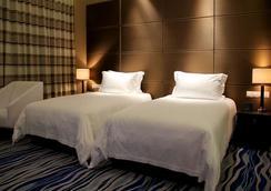 煙台百納瑞汀酒店 - 煙台 - 臥室