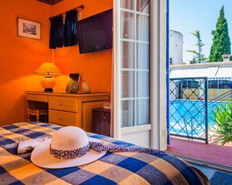 L'Hacienda - Маргеритт - Bedroom