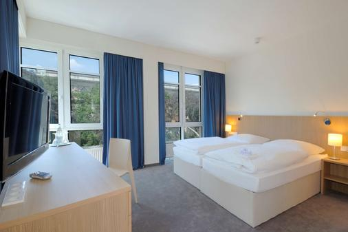 Hotel Berlin Mitte by Campanile - Berlin - Bedroom