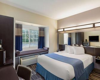 Microtel Inn & Suites by Wyndham Brooksville - Brooksville - Спальня