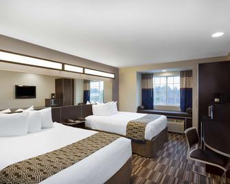 Microtel Inn & Suites by Wyndham Brooksville - Brooksville - Ložnice