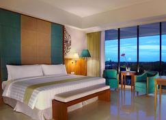 Aston Bojonegoro City Hotel - Bojonegoro - Спальня
