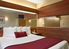 Days Inn & Suites by Wyndham Lafayette IN - Lafayette - Makuuhuone