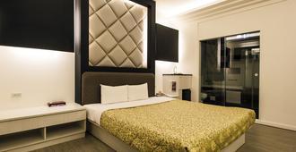 Yuan Chyau Motel - Taichung - Schlafzimmer