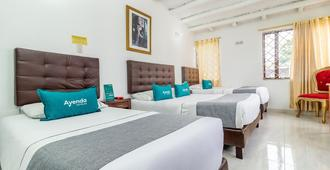 Ayenda Casa Hotel Victoria - Bogotá - Bedroom