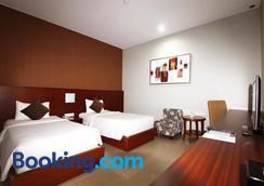 Grand Hatika Hotel - Tanjung Pandan - Bedroom