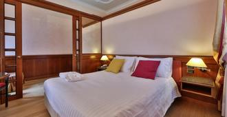 베스트 웨스턴 호텔 모데르노 베르디 - 제노바 - 침실
