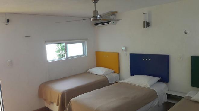 Hotel Maria Guadalupe - Valladolid - Schlafzimmer