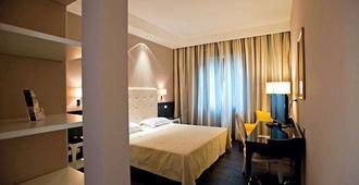هوتل ميدتيرانيو - باليرمو - غرفة نوم