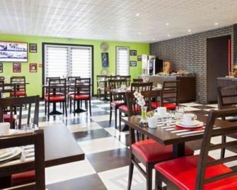 Enzo Hôtel - Бретіньї-сюр-Орж - Ресторан