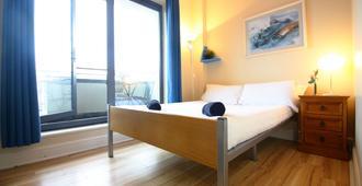 Snoozles Tourist Hostel - Galway - Habitación