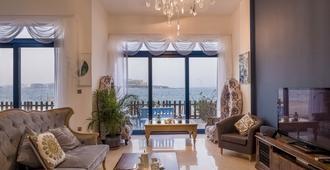 Bravoway Home - Palma Residence Villa - דובאי - סלון