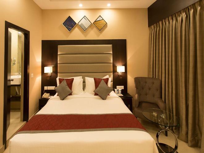 加爾各答金鬱金香飯店 - 加爾各答 - 臥室