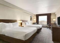Days Inn & Suites by Wyndham Yorkton - Yorkton - Bedroom