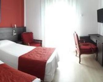 Aer Hotel Malpensa - Oleggio - Camera da letto
