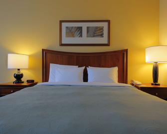 Country Inn & Suites by Radisson, Orangeburg, SC - Orangeburg - Schlafzimmer