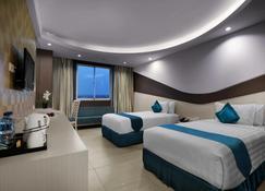 Aston Cirebon Hotel & Convention Center - Черибон - Спальня