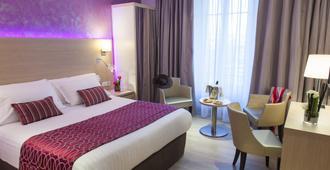 Best Western Plus Hotel Carlton - אנסי - חדר שינה