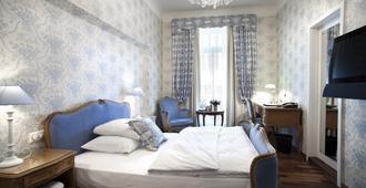 Romantik Hotel Europe - Zürich - Schlafzimmer