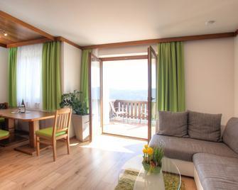 Mathiasl - Panorama Ferienwohnung - Bodensdorf - Living room