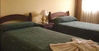 Hotel Guemes - Salta - Bedroom