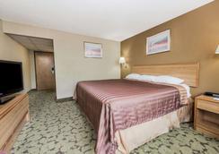 Travelodge by Wyndham Bloomington - Bloomington - Bedroom