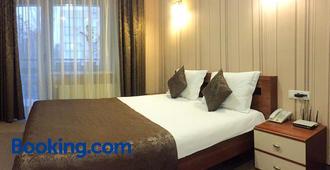 コミルフォ ホテル - キシニョフ - 寝室