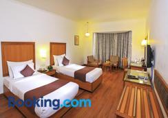 Hotel Abad Plaza - Kochi - Bedroom