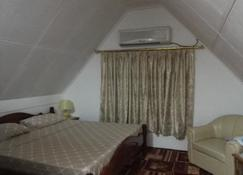 Loversnest Self Catering - Anse aux Pins - Sypialnia