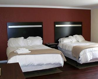 Budget Inn and Suites - Wall - Bedroom