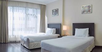 Tulip Inn Bahrain Suites And Residences - Manama - Habitación