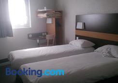 阿萊尼斯尼姆中心住宿加早餐酒店 - 尼姆 - 臥室