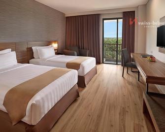 Swiss-Belhotel Sorong - Соронг - Спальня
