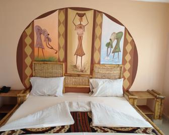 Bamboo Garden Hotel - Serrekunda - Slaapkamer