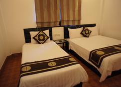 방비엥 부티크 호텔 - 방 비엥 - 침실