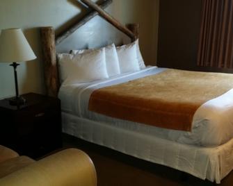 Rawlins Western Lodge - Роулинз - Спальня